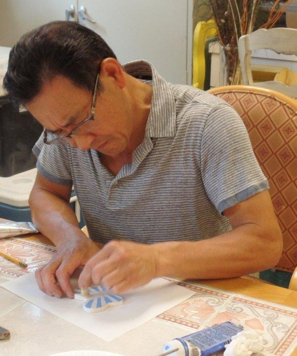 man making butterfly art