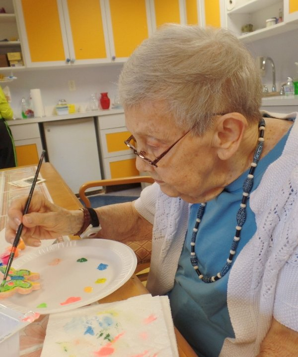 woman painting butterfly art
