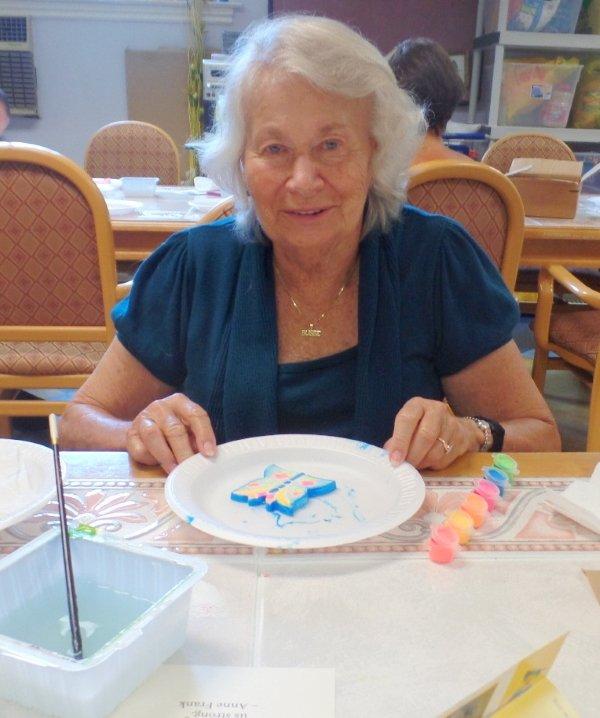 woman shows butterfly art