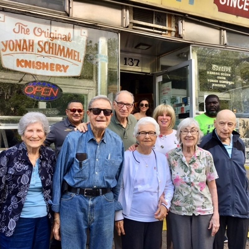 group posed before knish shop